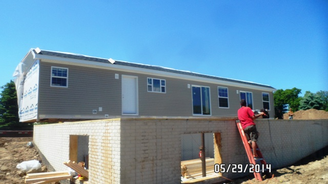 Process of building a modular home on a poured basement in for Modular homes with basement
