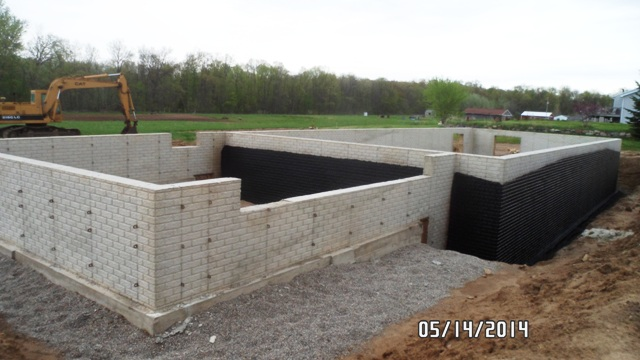 Process of building a modular home on a poured basement in for Prefab basement walls cost