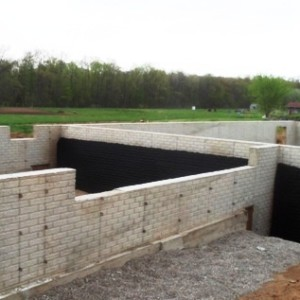 Modular home foundation difference between poured for Prefab foundation walls