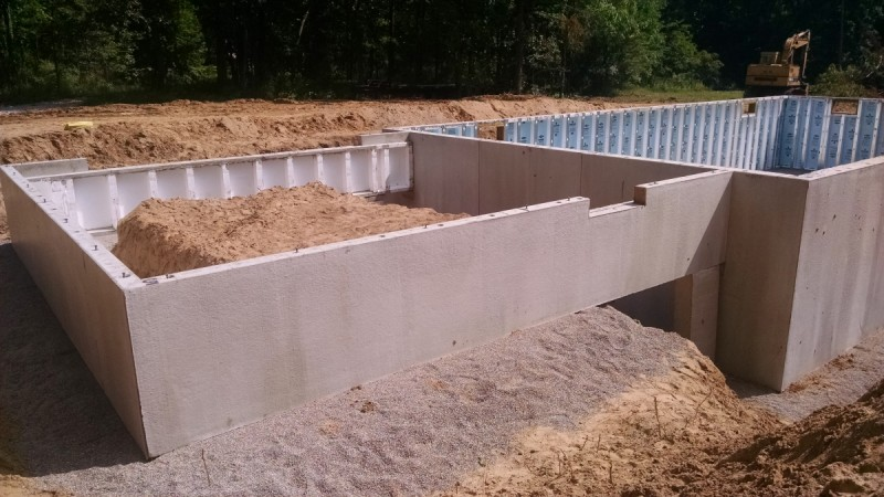 Steps of building a house pictures legendary homes for Superior foundation walls